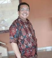 Drs. Husni Amriyanto Putra M.Si